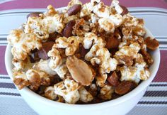 Healthier Cracker Jack Snack    Ingredients    10 cups of unsalted organic popcorn (homemade popcorn is best!)  1 cup of your favorite crispy nuts (we like a combo of almonds and peanuts)  4 tbsp of butter, plus extra for baking sheet  1/2 cup Rapadura (or sucanat)  1/8 tsp sea salt  2 tbsp filtered water