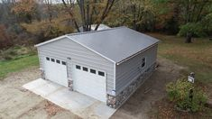 Beautiful stone finish! Carport Ideas, Metal Garages, Michigan, Shed, Outdoor Structures, Stone, Beautiful, Rock, Stones