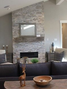 Stacked ledger stone gas fireplace with reclaimed barn beam mantel. Wall color Benjamin Moore Revere Pewt Stacked ledger stone gas fireplace with reclaimed barn beam mantel. Wall color Benjamin Moore Revere Pewter and Simply White trim. Ledger Stone Fireplace, Grey Stone Fireplace, Stacked Stone Fireplaces, Tall Fireplace, Home Fireplace, Fireplace Remodel, Living Room With Fireplace, Fireplace Surrounds, Fireplace Design