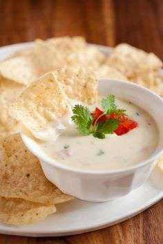 Queso Blanco Dip~ Ingredients: 2 Tbsp butter, 1/4 cup finely chopped onion, 1/4 tsp crushed garlic, 2 Tbsp all-purpose flour, 1 1/4 - 1 1/2 cups whole milk (for thicker sauce use lesser portion), 8 oz. finely shredded Monterey Jack cheese