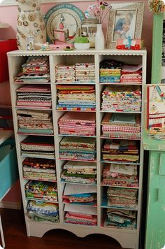 Cool cubbies for storing fabric scraps.  They look so pretty neatly folded on the shelves.