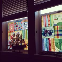 This is my new favorite window treatment.  Because our windows face directly into those of our neighbors, I added an extra measure of privacy with a cheerful stained glass effect.  The kids helped me laminate sheets of tissue paper designs, then I trimmed them and hung them on each window in my kids' room using just a dot of hot glue on the corner of each sheet.    They peel easily and cleanly off of the cold windows as-needed.  I'm curious to see if the same holds true when they warm up in…