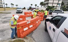 Jacksonville, Fla., Beach Public Works employees put up barricades to close off the 16th. Avenue South parking lot and stage heavy equipment as they prepare for Tropical Storm Hermine, now upgraded to hurricane status, Thursday, Sept. 1, 2016, ahead of it's expected Gulf Coast landfall Thursday night.