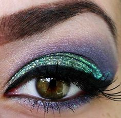 Gorgeous green with lilac / purple party eye makeup. Finish your look with black eyeliner and lots of black mascara