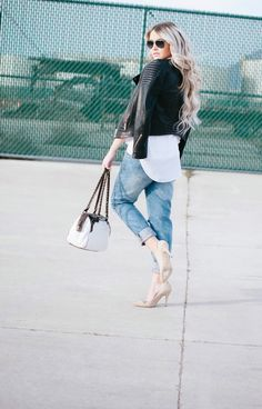 Cara Loren carrying a Patricia Nash Fabriano Satchel in Vintage Patent Leather.