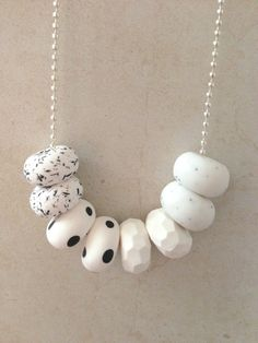 One of a kind polymer clay necklace.  Beads are handmade and threaded onto a 60cm ball chain.  This necklace is a mix of shapes and colours to create a