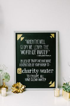 gold paint on chalkboard, photo by CarolineRo http://ruffledblog.com/charity-inspired-wedding-ideas #wedding #signs #chalkboard