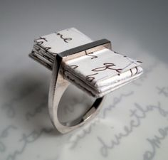 I Thou Ring keeps your vows or love letters bound together as a placeholder in a ring your loved one can wear. A unique ring created by OneOriginJewelry.