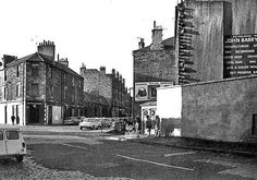 Police Box on the corner of Bonnington Road and Burlington Street, Leith - My father's birth certificate (David Urquhart 5.7.32 - 15.7.97) states that he was born at 1 Burlington Street, Leith. Family stories tell that this was above The Spotted Dog public House. This photograph shows a building to the left of the photograph which looks to contain a public house. More research required!