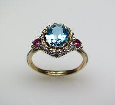 Blue Topaz & Ruby Ring in 14K Gold by FernandoJewelry on Etsy: Wow, very unique ring!