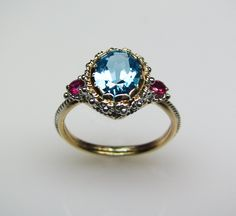 Blue Topaz & Ruby Ring in 14K Gold by FernandoJewelry on Etsy