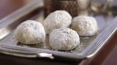 These buttery melt-in-your-mouth cookies go by many names but they are always twice rolled in powdered sugar and filled with finely chopped nuts.