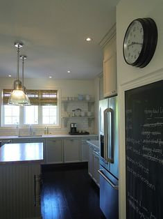 """I clad the bulkhead with trim and crown moulding to make it look deliberate and custom and I love it more than if the cabinets didn't have the buklhead."""""""