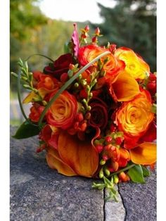 autumn centrepiece, seasonal flowers, orange and red floral centrepiece, table decor