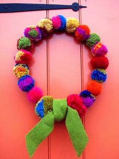 My Pom Pom wreath made on an embroidery hoop. From Kristin Nicholas' blog Getting Stitched on the Farm