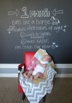 Paint a wall with chalkboard paint and write each month! This is adorable :)