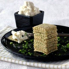 Chives and Sour Cream Crackers; Pile of Crackers, Cream Cheese in the Background | Low-Carb, So Simple!