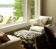 Distinctive Design Tips: Living Room Seating   Scale down a large living room by creating many gathering vignettes. Placing these chairs opposite each other along the window gives guests an option for quiet conversation.  #design #living room design #hoskins interiors