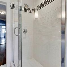 Beautiful bathroom with seamless glass shower and subway tile shower surround with black Greek key decorative tile. Beautiful Bathrooms, Modern Bathroom, Small Bathroom, Master Bathroom, Bathroom Tile Designs, Bathroom Floor Tiles, Bathroom Interior Design, Bathroom Ideas, Shower Bathroom