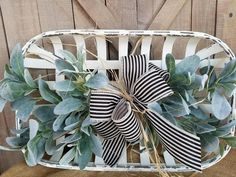 White Tobacco basket lambs ear arrangement. This beautiful basket arrangement would make a great statement on the wall or on a coffee/dining table. They perfect for the farmhouse decor, shabby chic home, rustic primitive home accent, the possibilities are endless. A great way to accentuate that classic look in any room