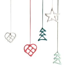 A set of five different handmade porcelain ornament with matching ribbons - packed in a delicious gift box of light brown carton.