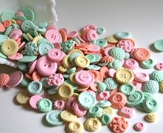 Candy buttons. Super expensive to buy, but not a big deal to make. Get silicone button molds, or make your own using vintage buttons, food coloring and gum paste.