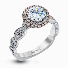 Featuring an elegant twisted contemporary design, this white and rose gold engagement ring complemented by .51 ctw of shimmering round cut white diamonds.