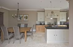 This kitchen blends Natural Oak base cabinets combined with hand painted wall and island furniture.
