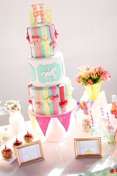 Love how they did the bows to look like ribbons.  Super cute circus themed wedding cake