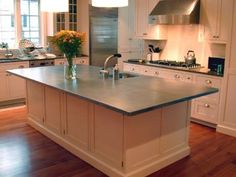 Soapstone countertops and zinc countertop on the island Zinc Table, Painted Cupboards, White Cabinets, Kitchen Cabinets, Installing Hardwood Floors, Wood Flooring, Soapstone Countertops, Countertop Materials, Bathroom Countertops