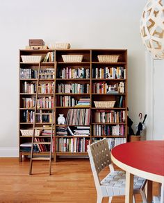 Put your library in an accessible area so you will actually use it. This collection of books was put near the eating area. Who doesn't love eating breakfast with a good read? Source: Lucas Allen via Domino