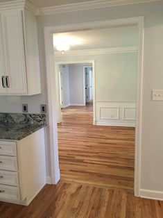 Solid Hardwood Floors Refinished 40 yr old wood in dining and new hardwood in kitchen. Wood: Red Oak  Stain: Natural Oak