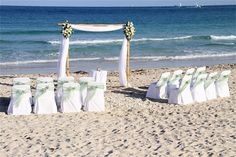Affordable Beach Weddings - A Little More Packages - Miami, FL. $2,699 includes wedding officiant, video of ceremony, up to 50 chairs with covers/bows delivery and set-up, 6 decorated tiki torches, real flowers on an arch--you choose the colors, rose petals on aisle. For $1,999 no chairs.