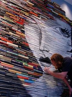 Book art  Mike Stilkey. Books are literally painted on. Installations.