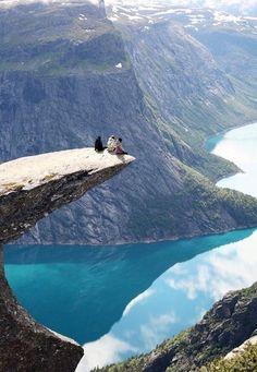 Sitting on an edge.