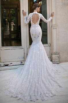 Berta handcrafted long sleeve lace wedding dress with illusion