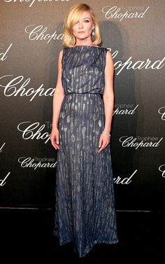 Kirsten Dunst in a smoke-blue gown printed with spoons (seriously!) and Chopard gems at the Chopard Trophy Ceremony.