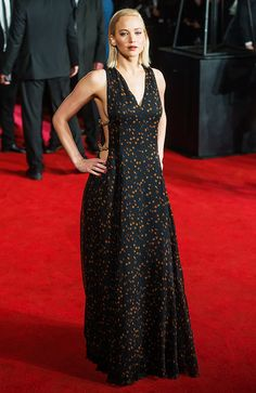 Jennifer Lawrence wars a printed Christian Dior Couture dress with chain strap detailing