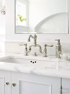 Even the simplest of vanities and sinks can be elevated with a beautiful faucet, whether you love the intricate, vintage look of a bridge style faucet, or the sleek, contemporary lines of a streamlined model. http://www.bhg.com/bathroom/remodeling/planning/bath-details/?socsrc=bhgpin031415sculpturalfaucet&page=5