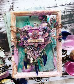 Altered frame by Juliya Tirskaya created for Mixed Media Place May 2017 challenge