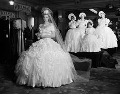 1938. A wedding gown being modeled at Grosvenor House in London. Forty eight yards of satin and twenty yards of tulle were used to make the dress. | 36 Vintage Wedding Dresses From Way Before You Were Born
