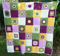 Sampler Blanket in green, white, yellow, and shades of purple. (Inspiration ~ color and types of blocks