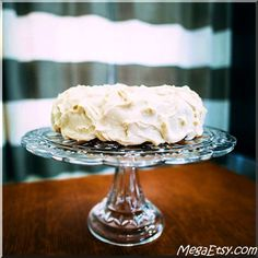 Moist, homemade carrot cake topped with cream cheese icing & caramel rum sauce. Totally crave-worthy.