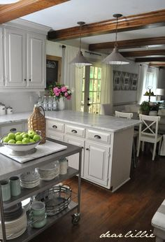 Our Kitchen Makeover (Before and Afters and a Full Source List) by Dear Lillie…love the pendant lights...