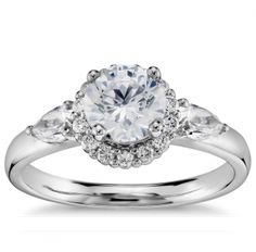 Stunning halo engagement ring with side accent stones. <3