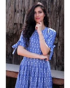 Shop online Steel blue knot sleeve dress A blue dress is a summer essential. Wear this steel blue ikat midi with knotty sleeves to look effortlessly chic this summer! Cotton Dress Indian, Cotton Long Dress, Casual Frocks, Casual Day Dresses, Kurti Sleeves Design, Sleeves Designs For Dresses, Simple Kurti Designs, Kurta Designs, One Piece Frock