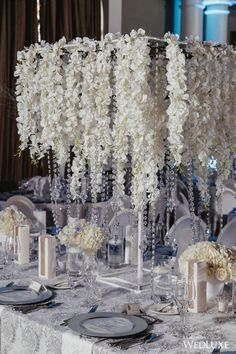 Flowers everywhere! | WedLuxe – Let It Snow | Photography by: MPSG Weddings Follow @WedLuxe for more wedding inspiration! #wedluxe #wedluxemagazine #wedding #weddinginspo #flowers #tabledecor #crystals