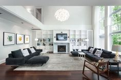 Favorite living room combo so far with dark wood floors and light gray/white walls