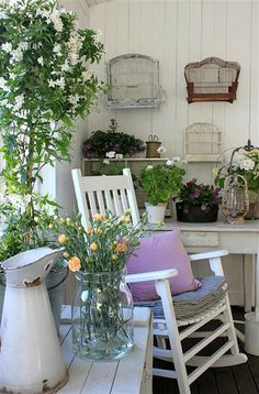 .Use this porch as my guide: hang things on wall, put plants on table, rustic white pitcher, clear vase with flowers.