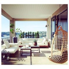 Love the hanging chair and set up for a balcony